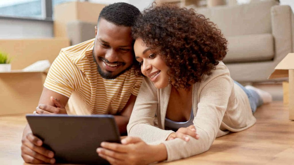 Mortgage Rates - Couple Searching Internet | New Orleans Local